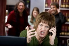 Annoying woman on her cell phone Royalty Free Stock Photography