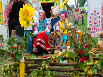 Annual agro exhibition SUMY-2012. SUMY, UKRAINE - SEPTEMBER 22: Women wearing historical costume posing in traditional village background on annual agro Royalty Free Stock Photos