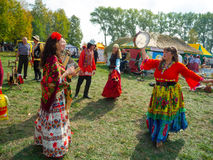 Annual agro exhibition SUMY-2012. SUMY, UKRAINE - SEPTEMBER 22: Unidentified people wearing historical Gypsy costumes dancing on annual agro exhibition SUMY-2012 Stock Photos