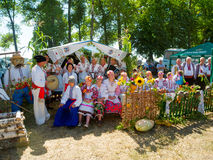 Annual agro exhibition SUMY-2013. SUMY, UKRAINE - AUGUST 17: Women wearing historical costume posing in traditional village background on annual agro exhibition Stock Photo