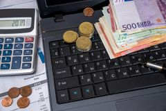 Annual budget, marketing research and business report with laptop royalty free stock photo