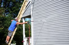Power washing. Annual chore of cleaning house siding royalty free stock photo