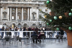Annual Christmas Ice Rink at the Historic Somerset House. LONDON,UK-NOVEMBER 25: Skaters Beating the Winter Blues at the Annual Christmas Ice Rink at the Royalty Free Stock Photo