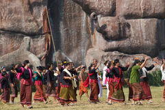 The Annual Elephant Roundup in Surin, Thailand. SURIN - NOVEMBER 21: Dancers in traditional farmer's outfits dancing their way onto the stadium during The Annual Stock Image