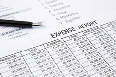 Annual expense report. With pen pointing at EXPENSE REPORT word royalty free stock photos