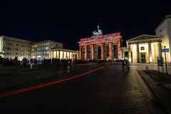 The annual Festival of lights 2018. Berlin. Germany. BERLIN - OCTOBER 07, 2018: Pariser Platz and Brandenburg Gate in brightly colored illuminations. Festival royalty free stock photography