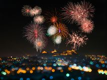 Annual Festival in Phetchaburi, Thailand. There is a beautiful fireworks above the palace on the top of the hill with bokeh decorative lights Stock Photos