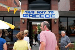 Annual greek food fest. NILES,ILLINOIS JULY 2012  People entering the St. Haralambos big greek food fest of Niles July 2012 in the Chicago suburb Niles,Illinois Royalty Free Stock Photos