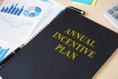 Annual incentive plan on a desk. Annual incentive plan on an office desk royalty free stock images