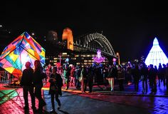 An annual outdoor lighting festival with immersive light installations and projections `Vivid Sydney` near The harbour bridge. stock photo