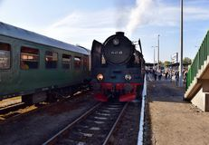 The annual parade about steam locomotives in Wolsztyn, Poland. Wolsztyn, Poland - April 28, 2018: The parade of steam locomotives in Wolsztyn. The annual show royalty free stock photos