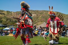 Powwow. Men`s Traditional Dance simulates a warrior performing scouting duties before a battle. stock images