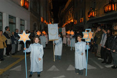 The annual procession to Jesus Christ at Easter in Mendrisio. Mendrisio, Switzerland - 18 april 2003: people carrying lanterns during the annual procession to Stock Photo