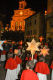 The annual procession to Jesus Christ at Easter in Mendrisio. Mendrisio, Switzerland - 19 april 2003: people carrying lanterns during the annual procession to Royalty Free Stock Photography