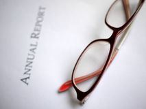 Annual report. Cover of annual report with glasses Royalty Free Stock Image