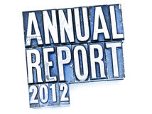 Annual Report. The phrase Annual Report in letterpress type. Cross processed, narrow focus stock image