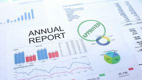 Annual report approved, seal stamped on official document, business project. Stock photo royalty free stock image