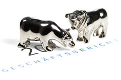 Annual report. German annual report with bull and bear figures royalty free stock image