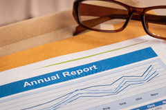 Annual Report letter document and eyeglass Royalty Free Stock Image
