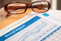 Annual Report letter document and eyeglass Royalty Free Stock Images