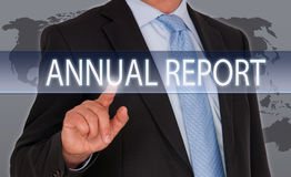 Annual Report - Manager with touchscreen. On world map background royalty free stock image