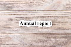 Annual report of the word on paper. concept. Words of Annual report on a wooden background Stock Photo