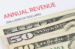 Annual Revenue report with US banknote. Close up shot of annual Revenue report with US banknote stock photos