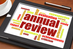 Annual review word cloud on tablet Stock Photos