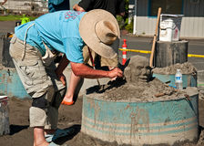 Annual Sandsation Competition. LONG BEACH, WA – JULY 20 – Master sandbuilders come to compete in the annual Sandsation competition, this unidentified man is Stock Photos