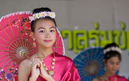 The annual Umbrella Festival in Chiang Mai. CHIANG MAI, THAILAND - JANUARY 15: Girls performing in national costumes during the annual Umbrella festival in Royalty Free Stock Images