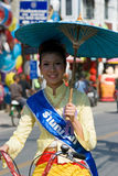 The annual Umbrella Festival in Chiang Mai. CHIANG MAI, THAILAND - JANUARY 15: Beauty contest participant on bicycle during the annual Umbrella festival in Bo Stock Images