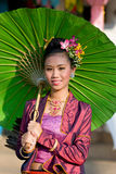The annual Umbrella Festival in Chiang Mai. CHIANG MAI, THAILAND - JANUARY 15: Woman in traditional costume during the annual Umbrella festival in Bo Sang Stock Photo