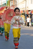 The annual Umbrella Festival in Chiang Mai. CHIANG MAI, THAILAND - JANUARY 15: Girls in traditional costumes during the annual Umbrella festival in Bo Sang Royalty Free Stock Image