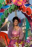 The annual Umbrella Festival in Chiang Mai. CHIANG MAI, THAILAND - JANUARY 15: Young woman in traditional costume during the annual Umbrella festival in Bo Sang Stock Photos