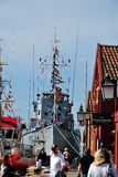 Annually Shellfish Festival Mandal, Norway. Narrow harbor with buildings and boats Royalty Free Stock Image