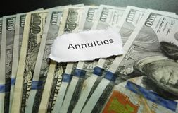 Annuity note. On top of assorted cash Royalty Free Stock Photos
