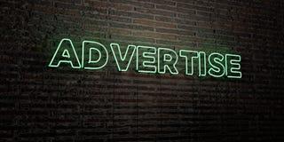 ANNUNCI - insegna al neon realistica sul fondo del muro di mattoni - l'immagine di riserva libera della sovranità resa 3D Immagini Stock Libere da Diritti