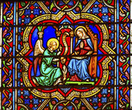 Annunciation Angel Mary Stained Glass Notre Dame Paris France. Annunciation Angel Gabriel Telling Virgin Mary About Jesus Stained Glass Notre Dame Cathedral stock photo
