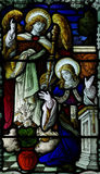 The Annunciation in stained glass: Mary and Gabriel Stock Image