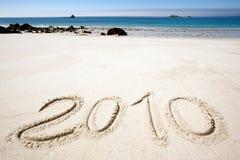 Ano 2010 na areia Fotos de Stock Royalty Free