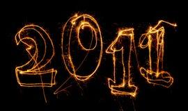 Ano 2011 escrito com sparklers Imagens de Stock