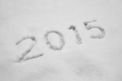 Ano 2015 escrito na neve Fotografia de Stock Royalty Free