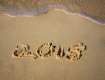 Ano 2015 na areia da praia Foto de Stock