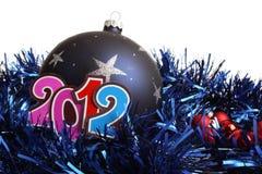 Ano novo 2012 e um bauble Fotografia de Stock