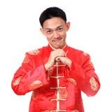 Ano novo chinês feliz Homem asiático novo com gesto do congratul Fotografia de Stock