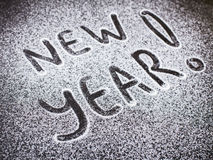 Ano novo da inscrição ao açúcar Fotografia de Stock Royalty Free