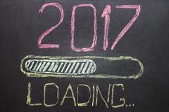 Ano novo de carregamento 2017 no quadro-negro Fotos de Stock Royalty Free