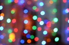 Ano novo e de borrão do Natal bokeh claro defocused fotografia de stock