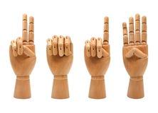 Ano novo feliz com as mãos de madeira que formam o número 2014 Imagens de Stock