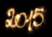 Ano novo feliz - 2015 com chuveirinhos Fotografia de Stock Royalty Free